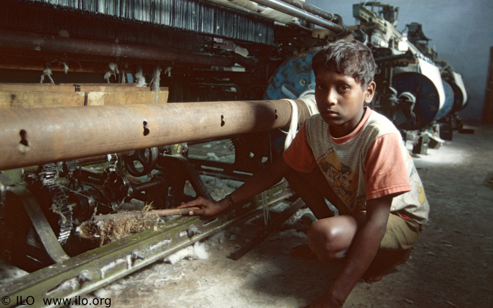 young boy working in a factory