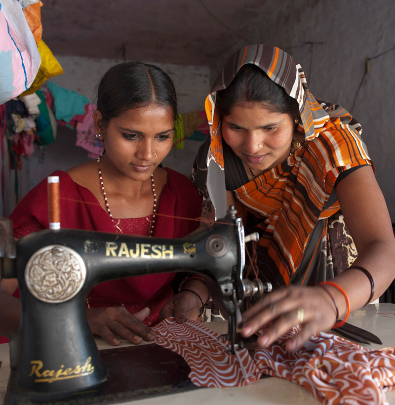 women using a sewing machine
