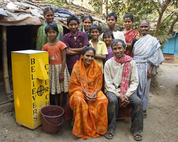 A family with a biosand water filter