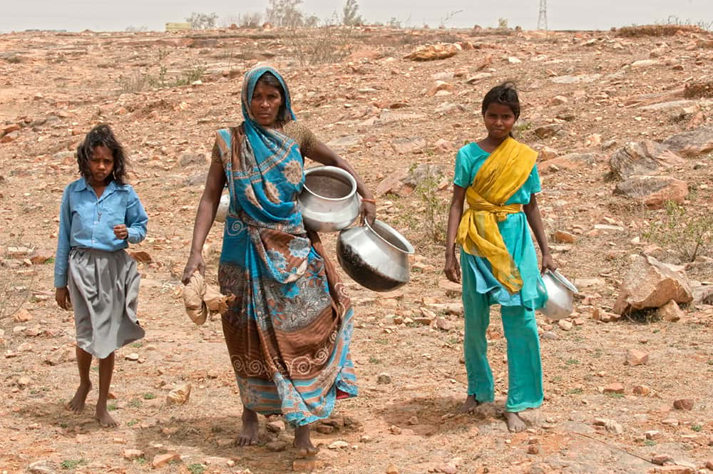 Mother with children at an area going through severe drought