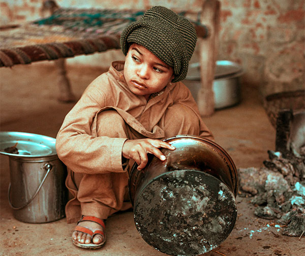 A child washes pots