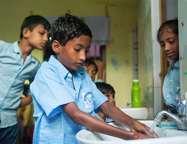 A Bridge of Hope child washes his hands