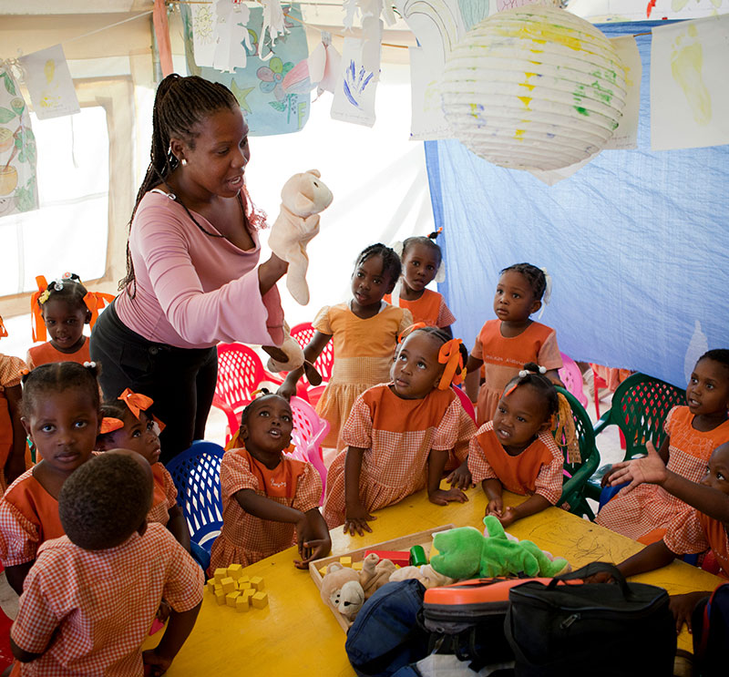 A teacher in a UNICEF-supported school teaches young children