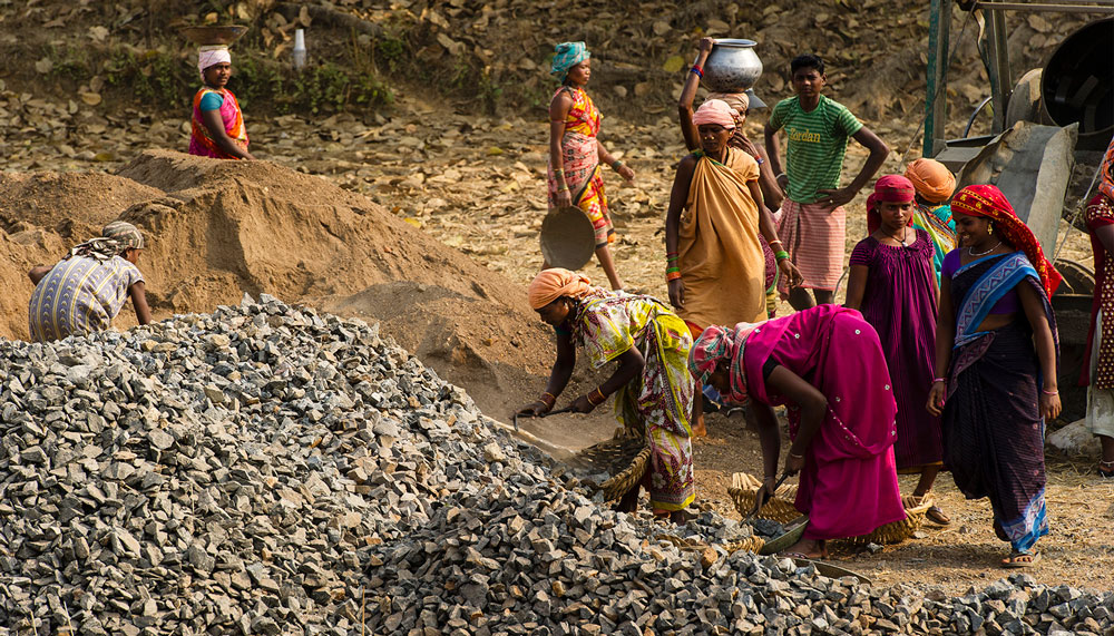 These women are working on road construction project in Asia.