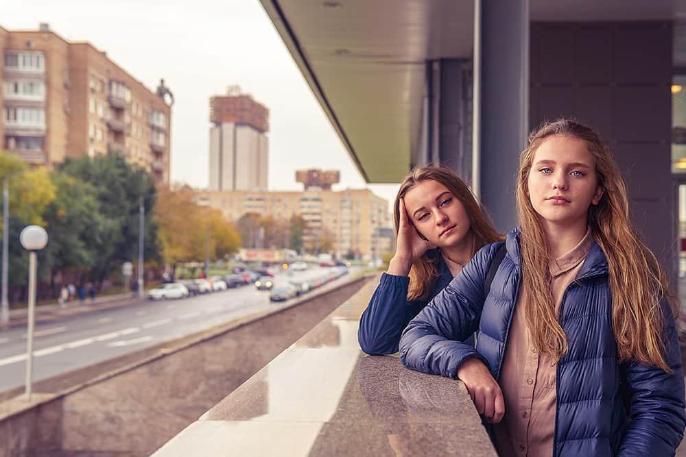 Two girls posing on a school balcony