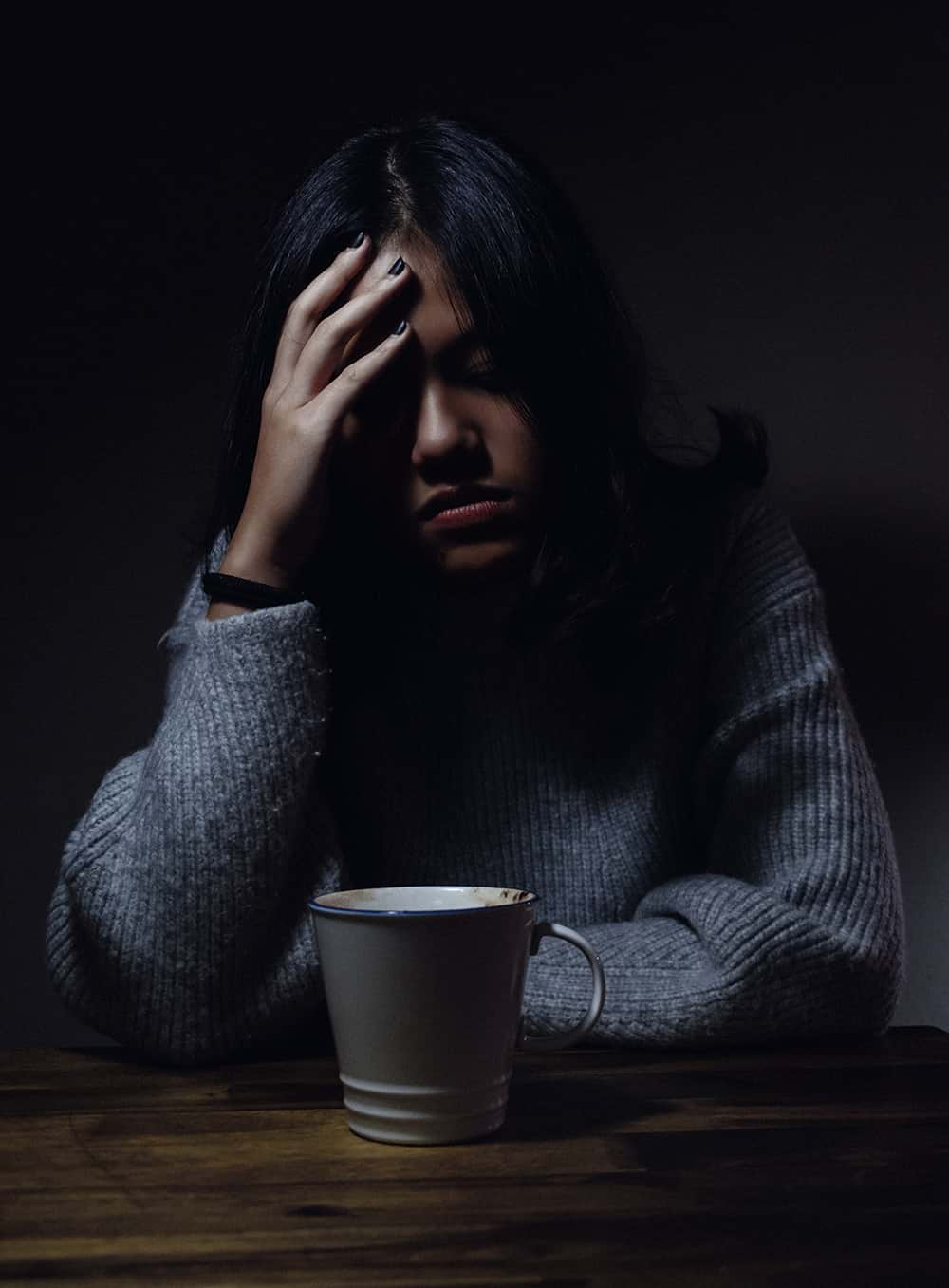 Woman suffering in darkness