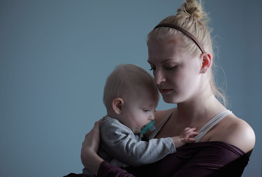 Pensive mother and child