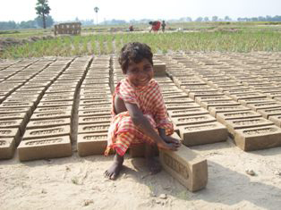 Five-year-old Bina working at a brick factory