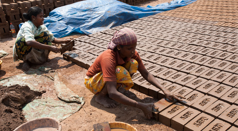 Most people in this woman's village are laborers at a brick factory. Women are often 'invisible' workers in brick kilns, vulnerable to exploitation and having little to no rights.