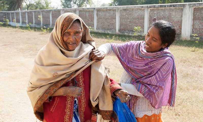This woman was given a new blanket during a gift distribution. Leprosy patients like her have almost no resources at their disposal, and gifts like blankets are a useful blessing.
