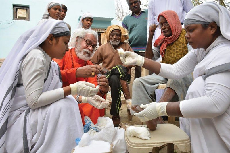 K.P. Yohannan during his visit to a leprosy colony