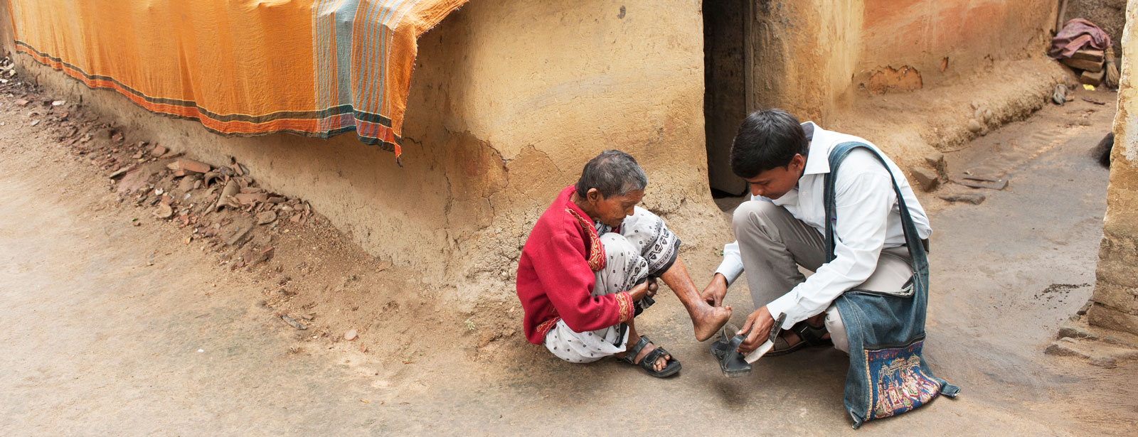 A GFA-supported pastor cuts the nails of a leprosy patient