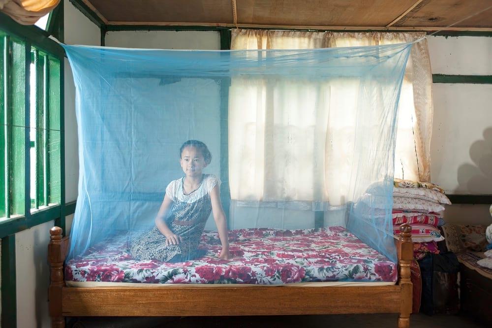 Girl resting under mosquito net