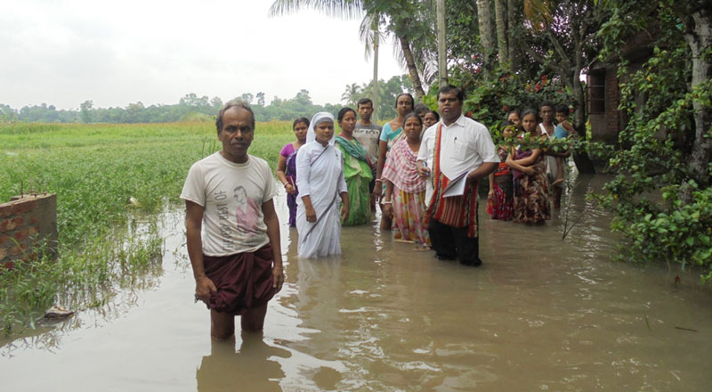 A GFA-supported pastor helps those affected by flooding in South Asia