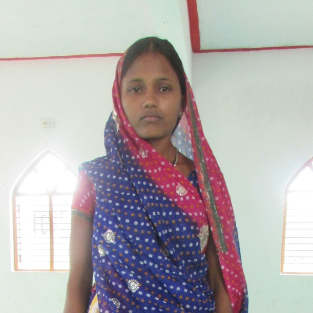 Shara, whose family is now protected with a mosquito net