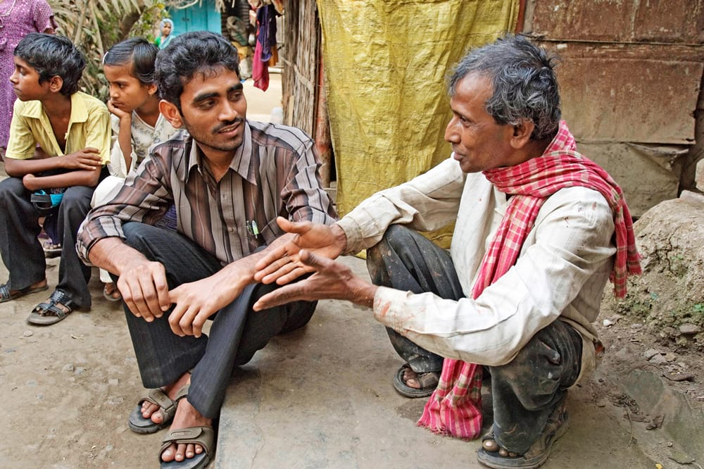 Asian missionary worker shares the love of Christ to his community