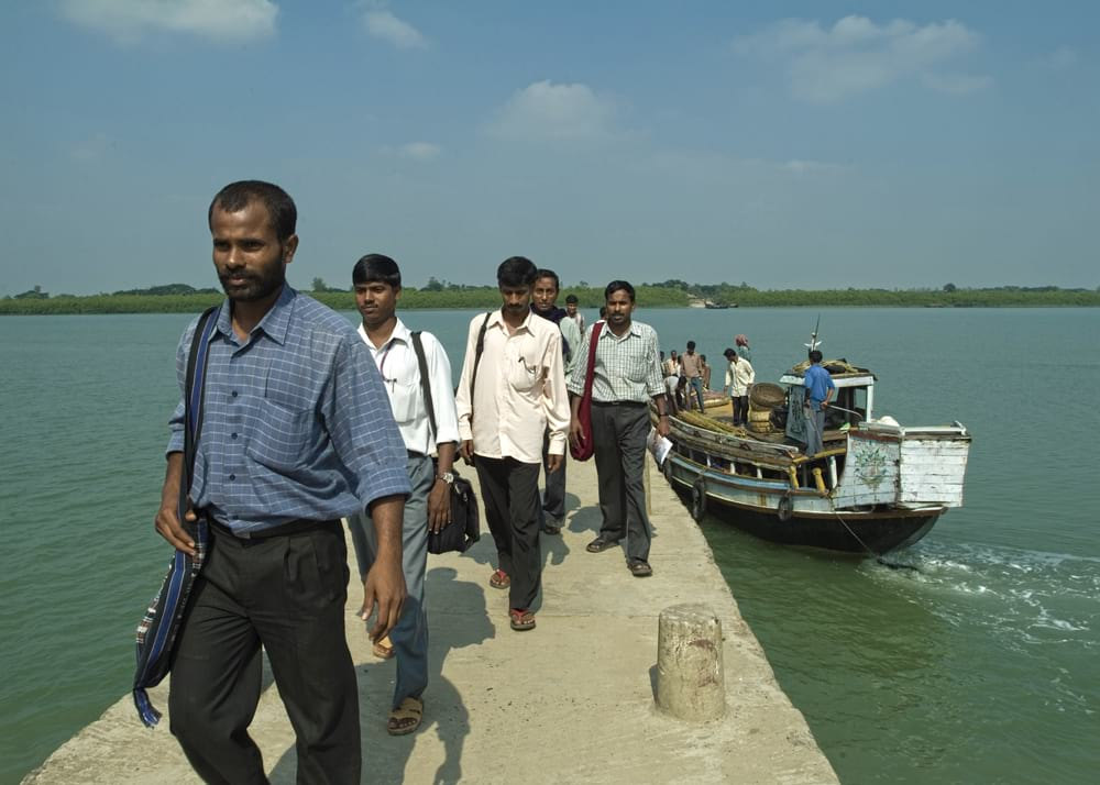 Ritesh and national workers travel between islands through boats to show the love of Jesus