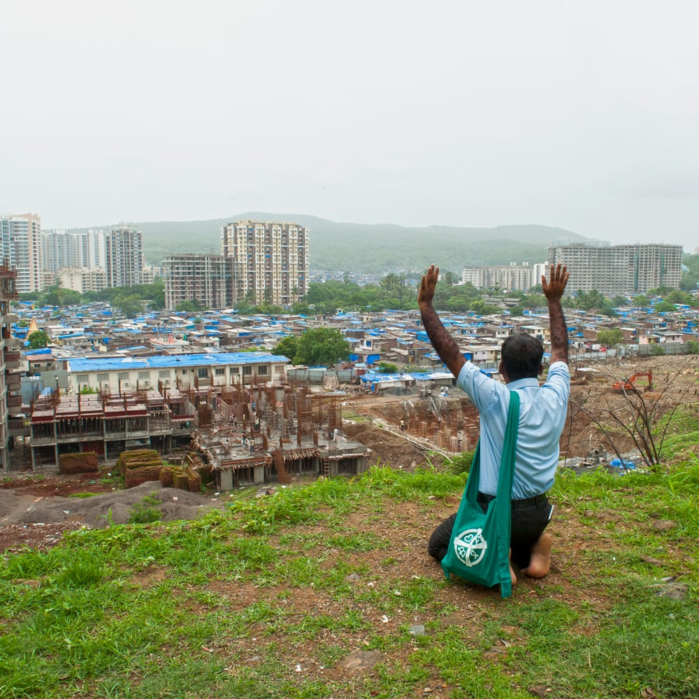 GFA Pastor Marty prays for the people living in the slums