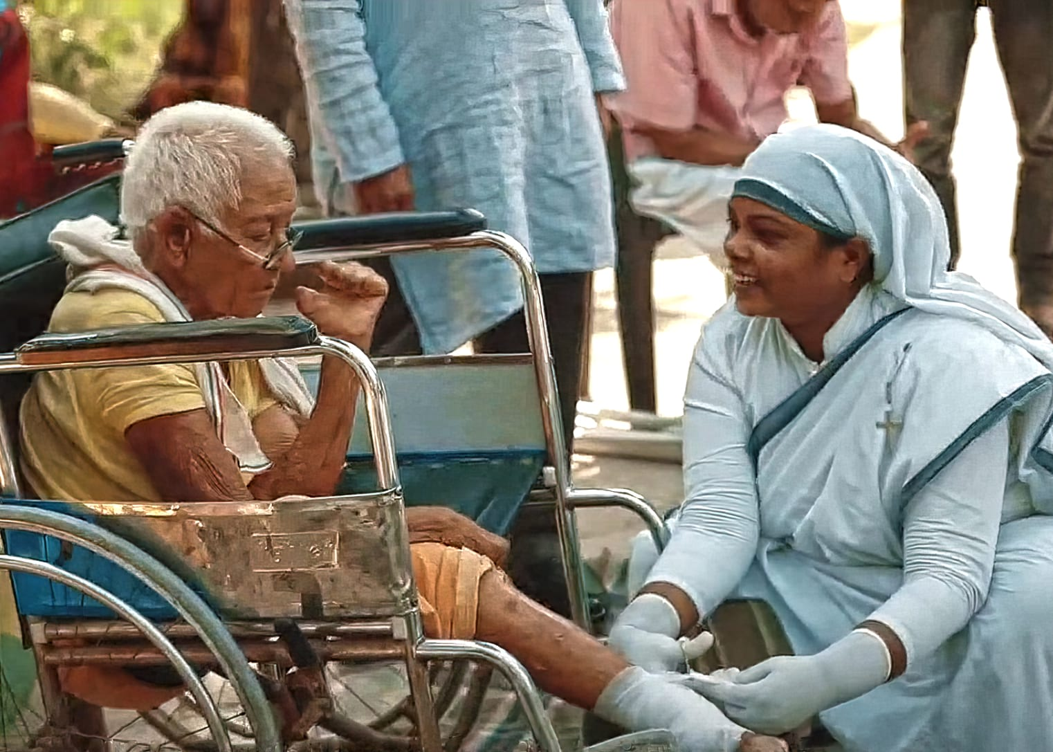 Geeta, Sisters of Compassion, cleans and bandages the wounds of a leprosy patient
