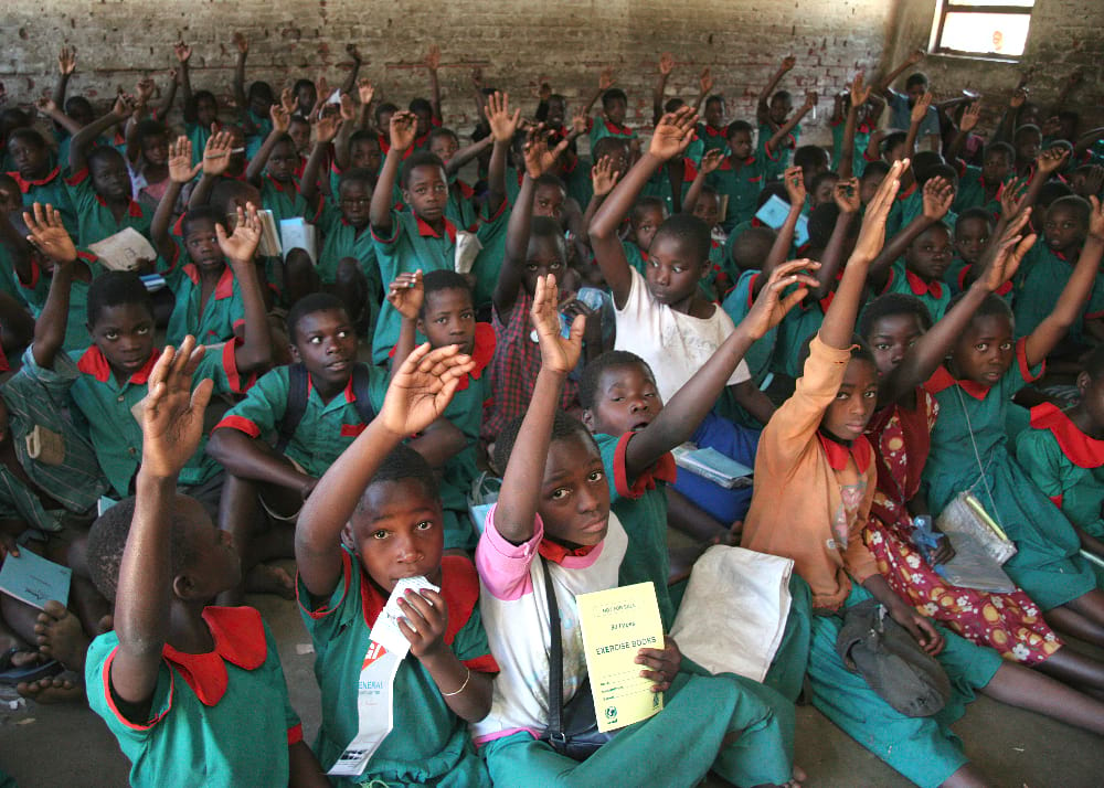 Children participate in a class on malaria and how to protect themselves