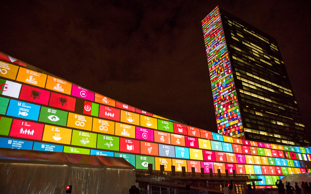 United Nations Building in New York on September 22, 2015, displaying the development goals and the flags of the 193 countries that agreed with them.