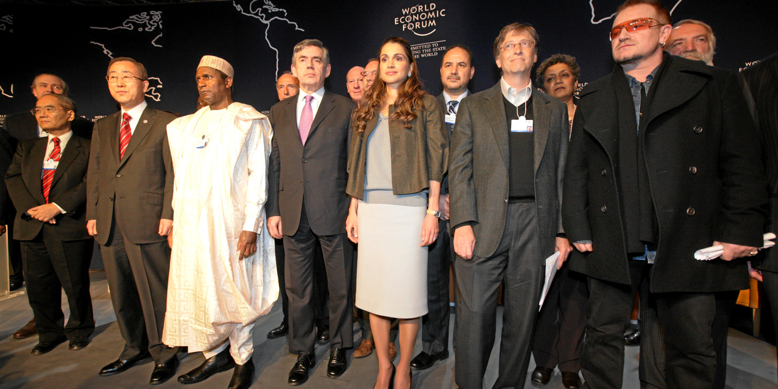 World Economic Forum participants stand together to 'Call to Action on the Millenium Development Goals' during the Annual Meeting 2008 in Davos, Switzerland, January 25, 2008.