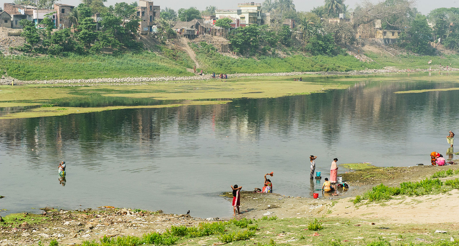 People washing clothes at the Ganges River. A water crisis in India, and a clean water shortage has created the need for water scarcity solutions.