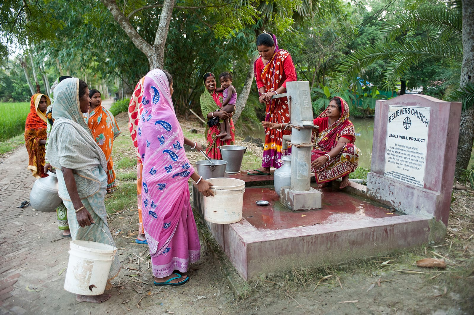 Group of women drawing clean water from Jesus Well.