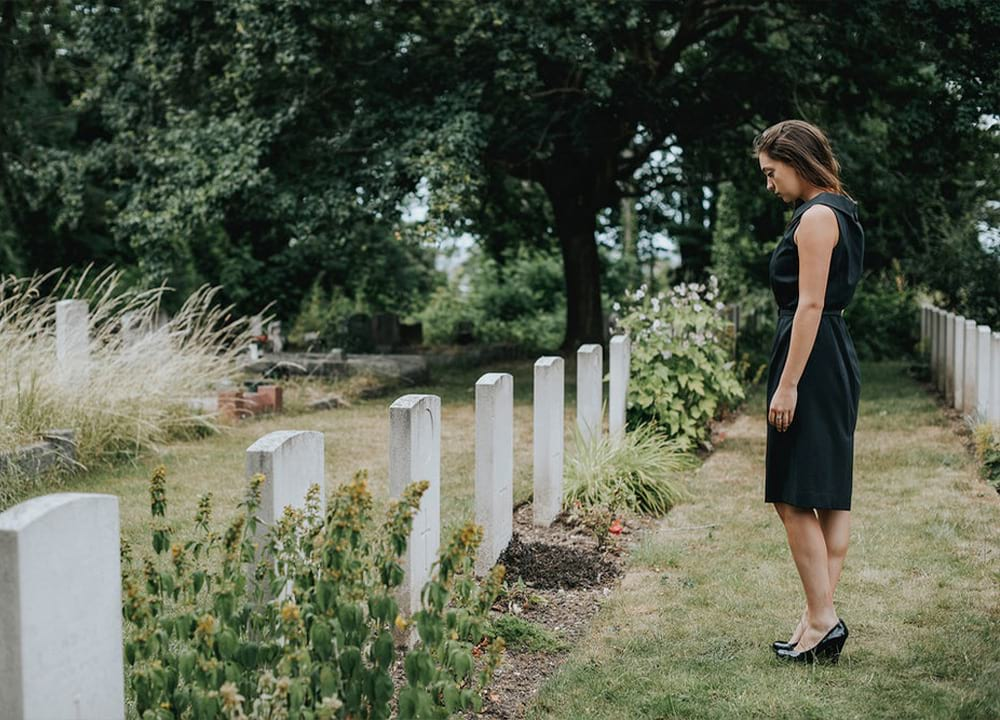 Widow at cemetery