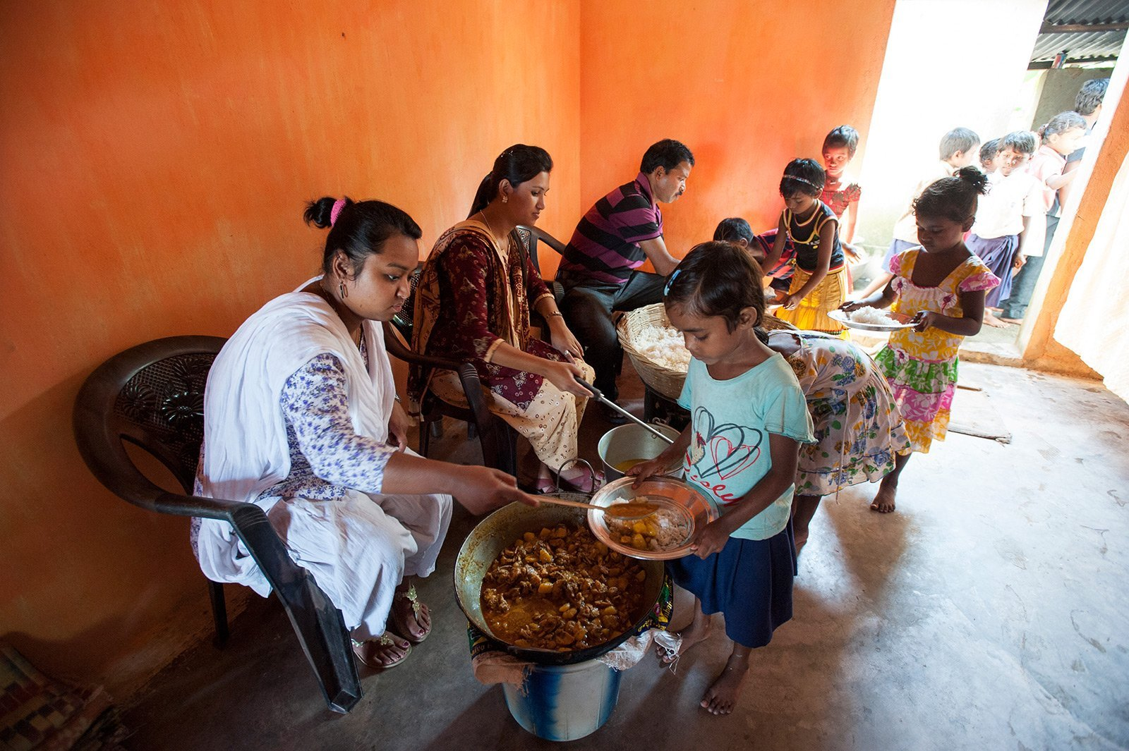 Gospel for Asia-supported workers feeding children
