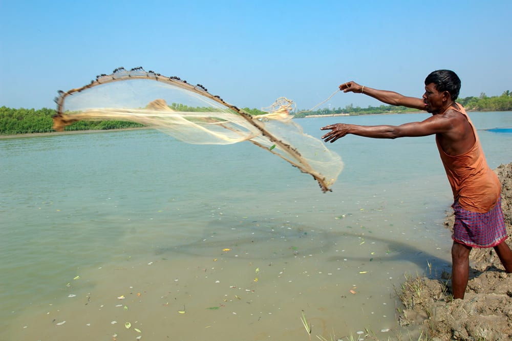 Man casting a fishing net
